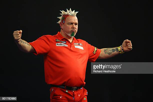 Peter Wright reacts to winning during his first round match against Keegan Brown on day one of the 2016 William Hill PDC World Darts Championships at...