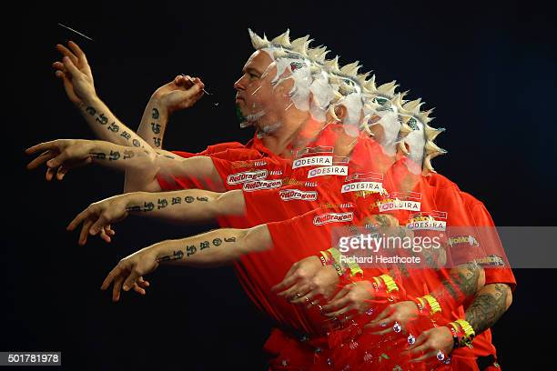 Peter Wright throws against Keegan Brown during the first round on day one of the 2016 William Hill PDC World Darts Championships at Alexandra Palace...