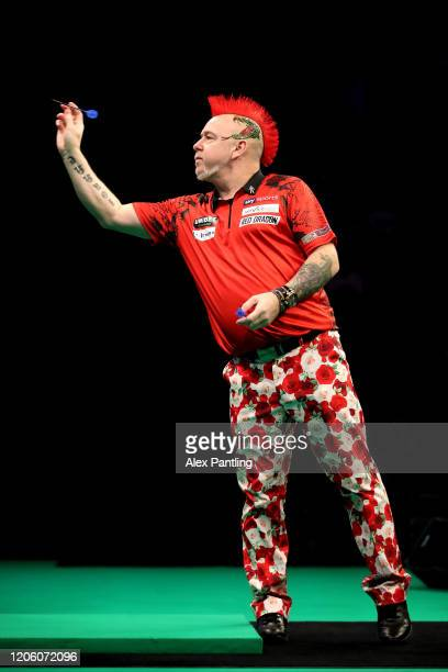Peter Wright throws in his match against Gary Anderson during day two of the Unibet Premier League at Motorpoint Arena on February 13 2020 in...