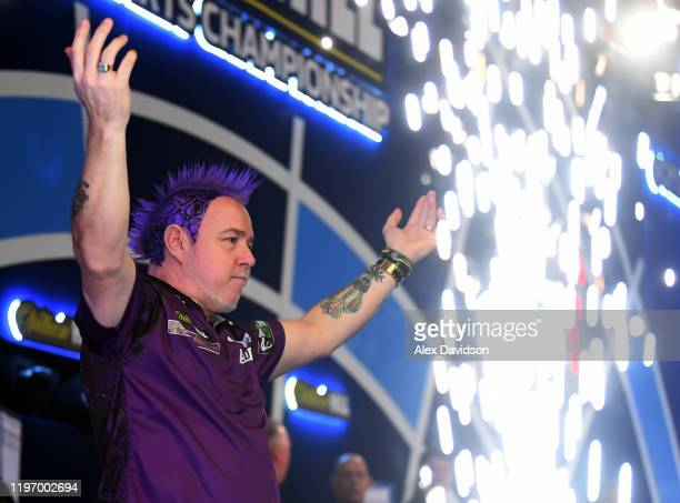 Peter Wright walks on during the Final of the 2020 William Hill World Darts Championship between Peter Wright and Michael Van Gerwen at Alexandra...