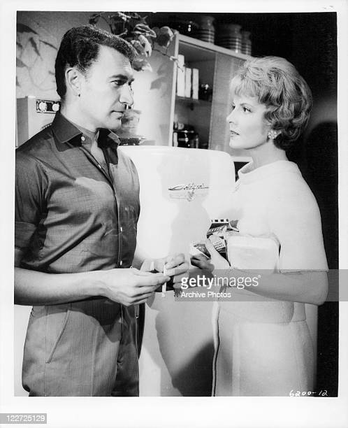 Peter Wyngarde and Janet Blair have discussion in the kitchen in a scene from the film 'Burn Witch Burn' 1962