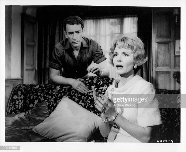 Peter Wyngarde looking over Janet Blair's shoulder in a scene from the film 'Burn Witch Burn' 1962