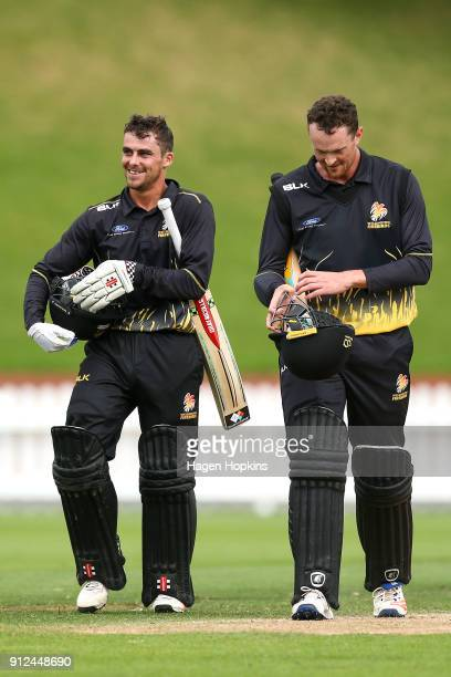 Peter Younghusband and Ollie Newton of the Firebirds leave the field after winning the Ford Trophy match between the Wellington Firebirds and the...
