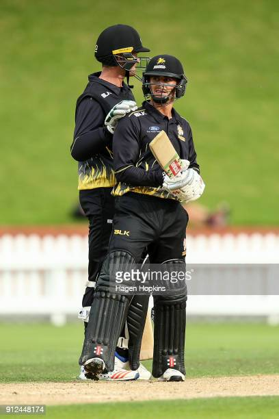 Peter Younghusband of the Firebirds celebrates his half century with teammate Ollie Newton during the Ford Trophy match between the Wellington...