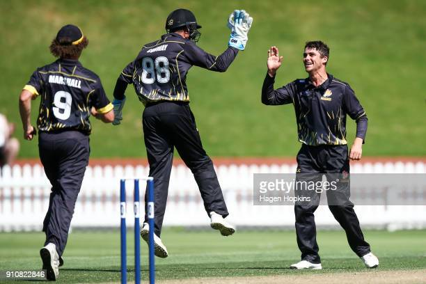 Peter Younghusband of the Firebirds celebrates with Devon Conway after taking the wicket of Nick Kelly of Northern Districts during the Ford Trophy...
