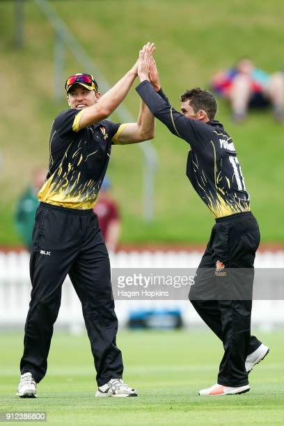 Peter Younghusband of the Firebirds celebrates with Logan van Beek after taking the wicket of Shawn Hicks of the Volts during the Ford Trophy match...