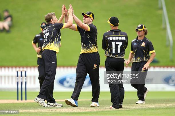 Peter Younghusband of the Firebirds celebrates with Michael Bracewell after taking the wicket of Derek de Boorder of the Volts during the Ford Trophy...