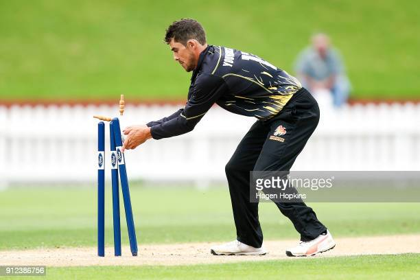 Peter Younghusband of the Firebirds takes the wicket of Shawn Hicks of the Volts during the Ford Trophy match between the Wellington Firebirds and...