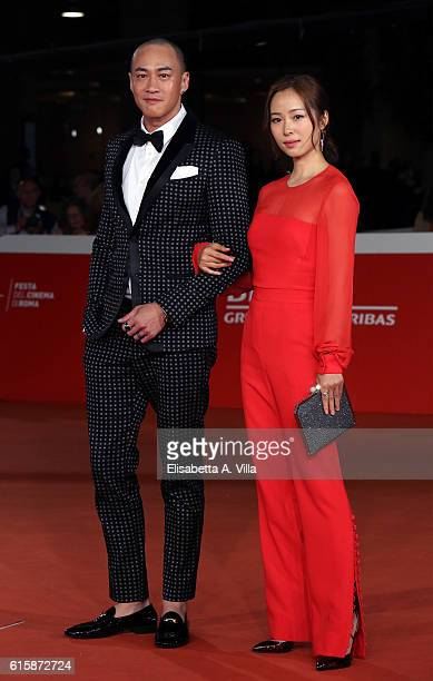 Peter Yun Tung Ho and Jiang Yiyan walk a red carpet for 'San Shao Ye De Jian Sword Master 3D' during the 11th Rome Film Festival at Auditorium Parco...