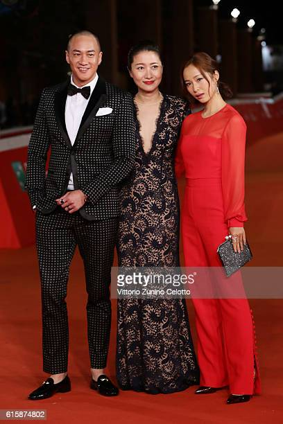 Peter Yun Tung Ho Mandy Law and Jiang Yiyan walk a red carpet for 'San Shao Ye De Jian Sword Master 3D' during the 11th Rome Film Festival at...