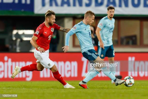 Peter Zulj of Austria and Steven Davis of Northern Ireland battle for the ball during the UEFA Nations League B group three match between Austria and...