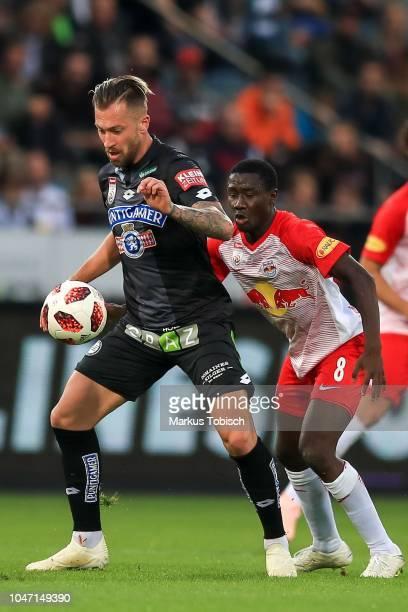 Peter Zulj of Sturm Graz and Diadie Samassekou of RB Salzburg during the tipico Bundesliga match between Sturm Graz and RB Salzburg at Merkur Arena...