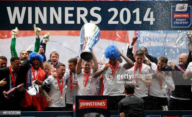 Peterborough captain Tommy Rowe lifts the trophy after his team won the Johnstone's Paint Trophy Final between Chesterfield and Peterborough United...