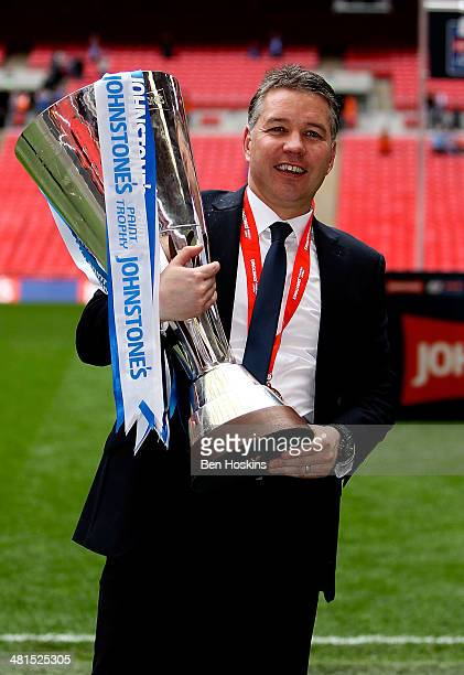 Peterborough manager Darren Ferguson celebrates with the trophy after his team won the Johnstone's Paint Trophy Final between Chesterfield and...