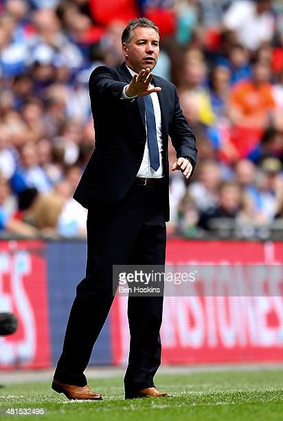 Peterborough manager Darren Ferguson gives instructions during the Johnstone's Paint Trophy Final between Chesterfield and Peterborough United at...