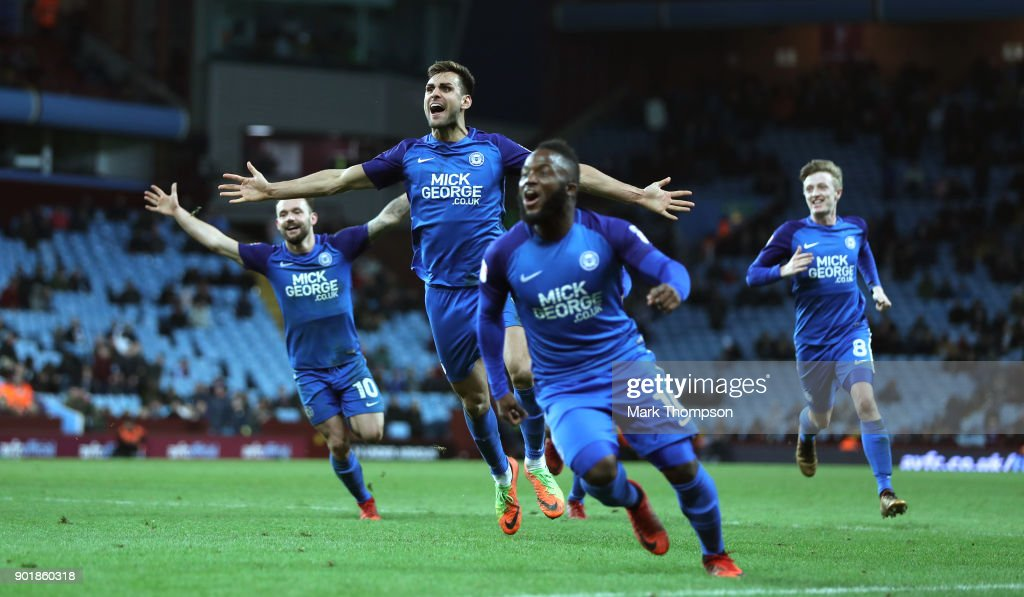 Peterborough player Ryan Tafazolli (2ndl) celebrates the second goal with team mates during the The Emirates FA Cup Third Round match between Aston Villa and Peterborough United at Villa Park on January 6, 2018 in Birmingham, England.