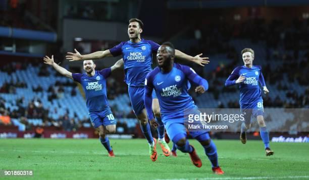 Peterborough player Ryan Tafazolli celebrates the second goal with team mates during the The Emirates FA Cup Third Round match between Aston Villa...