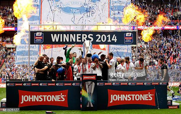 Peterborough players celebrate with the trophy after winning the Johnstone's Paint Trophy Final between Chesterfield and Peterborough United at...