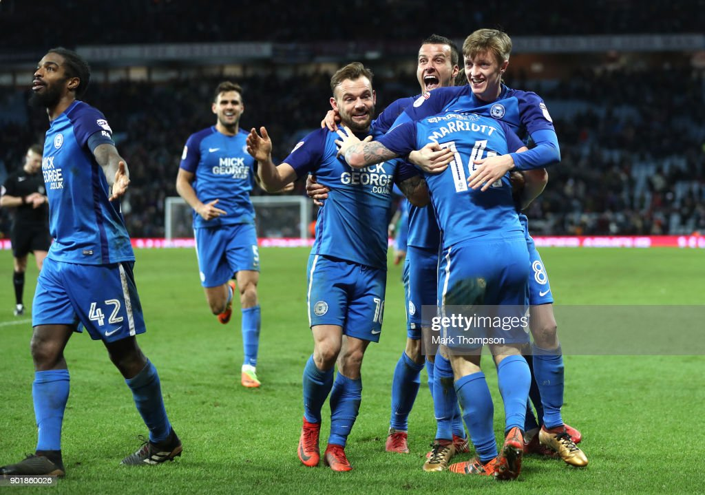 Peterborough players including Steven Taylor (3 r) celebrate after the The Emirates FA Cup Third Round match between Aston Villa and Peterborough United at Villa Park on January 6, 2018 in Birmingham, England.