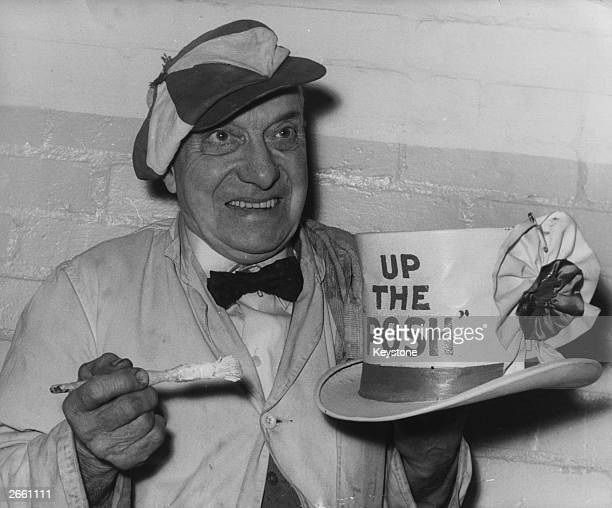 Peterborough United football club's mascot Dusty Hall painting his hat with the slogan 'Up The Posh' in preparation for his team's fourth round cup...