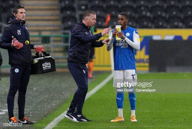Peterborough United manager Darren Ferguson gives instructions to Reece Brown during the Sky Bet League One match between Hull City and Peterborough...