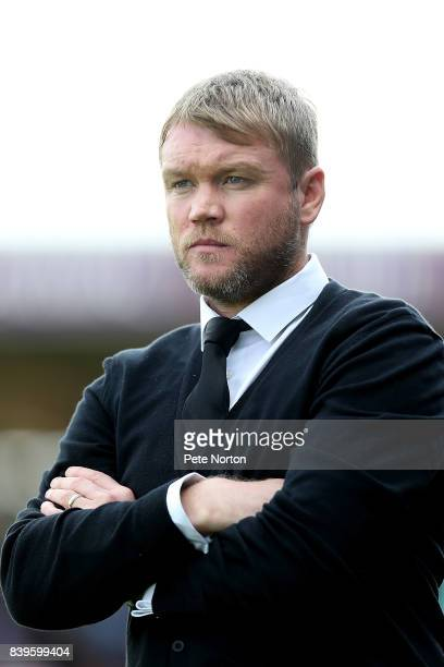 Peterborough United manager Grant McCann looks on during the Sky Bet League One match between Northampton Town and Peterborough United at Sixfields...