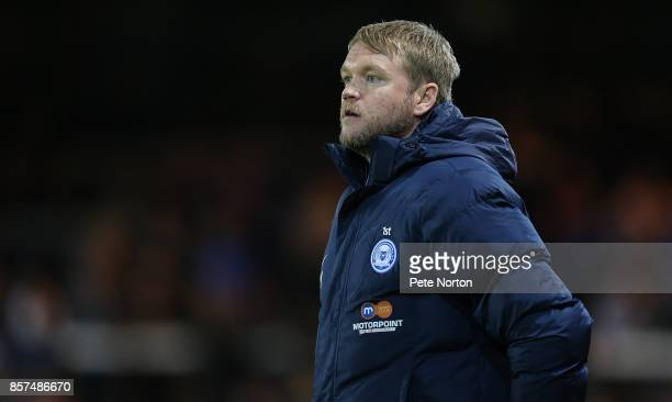 Peterborough United manager Grant McCann looks on during the Checkatrade Trophy match between Peterborough United and Northampton Town at The Abax...