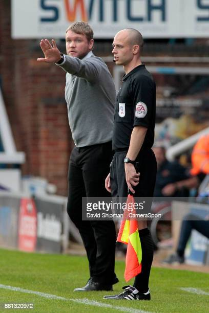 Peterborough United manager Grant McCann shouts instructions to his team from the dugout during the Sky Bet League One match between Peterborough...