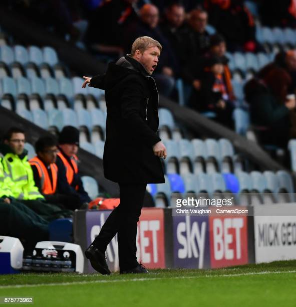 Peterborough United manager Grant McCann shouts instructions to his team from the technical area during the Sky Bet League One match between...
