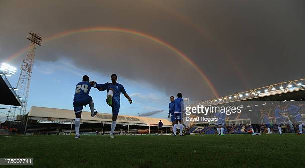 Peterborough United players warm up at half time underneath a rainbow during the pre season friendly match between Peterborough United and Hull City...