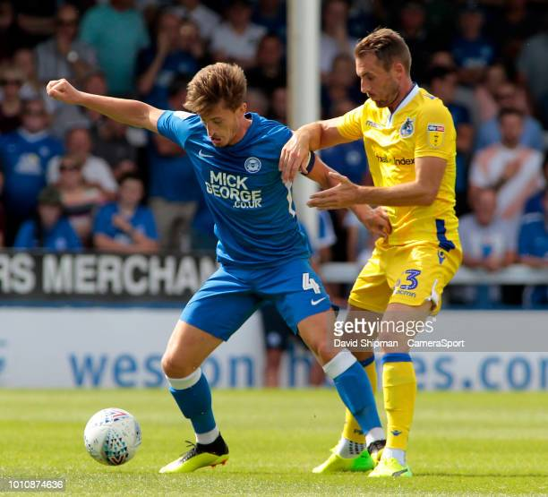Peterborough United's Colin Daniel holds off the challenge from Bristol Rovers' Alex Rodman during the Sky Bet League One match between Peterborough...