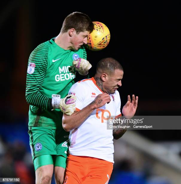 Peterborough United's Conor O'Malley heads the ball clear under pressure from Blackpool's Kyle Vassell during the Sky Bet League One match between...