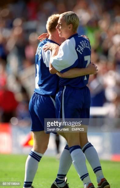 Peterborough United's David Farrell celebrates his goal with teammate David Oldfield