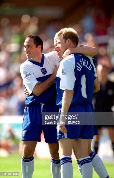 Peterborough United's David Farrell is congratulated by teammates Richard Forsyth and David Oldfield