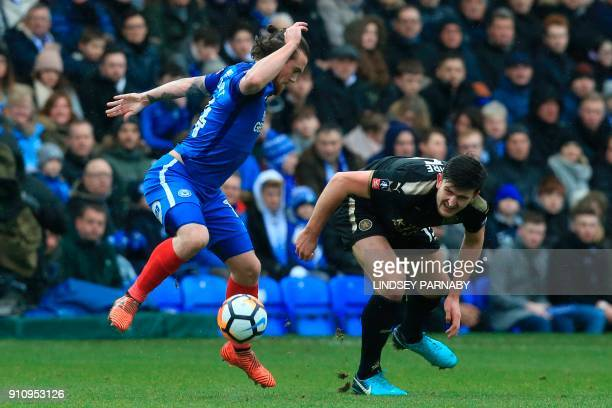 Peterborough United's English striker Jack Marriott takes on Leicester City's English defender Harry Maguire during the English FA Cup fourth round...