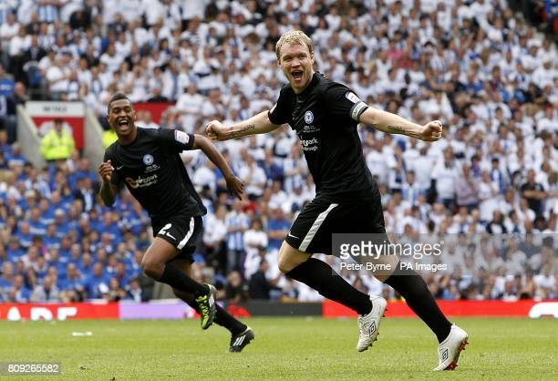 Peterborough United's Grant McCann celebrates after his freekick is turned in by team mate Tommy Rowe giving his side their first goal of the game