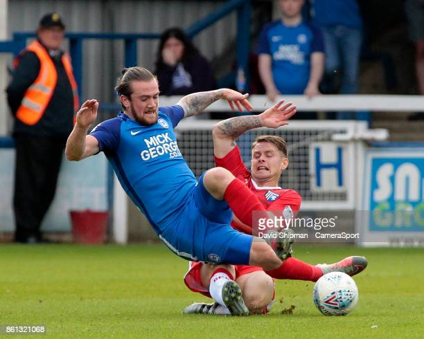 Peterborough United's Jack Marriott is tackled by Gillingham's Mark Byrne during the Sky Bet League One match between Peterborough United and...