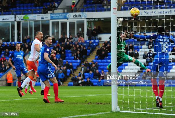 Peterborough United's Leo Da Silva Lopes heads an attempt at goal by Blackpool's Kyle Vassell off the goalline during the Sky Bet League One match...