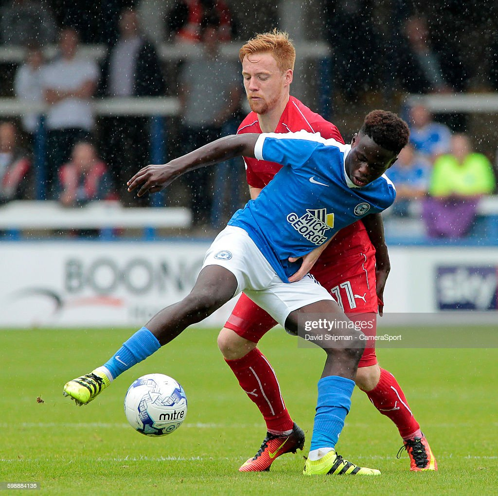 Peterborough United's Leo Da-Silva-Lopes battles with Swindon Town's James Brophy during the Sky Bet League One match between Peterborough United and Swindon Town at ABAX Stadium on September 3, 2016 in Peterborough, England.