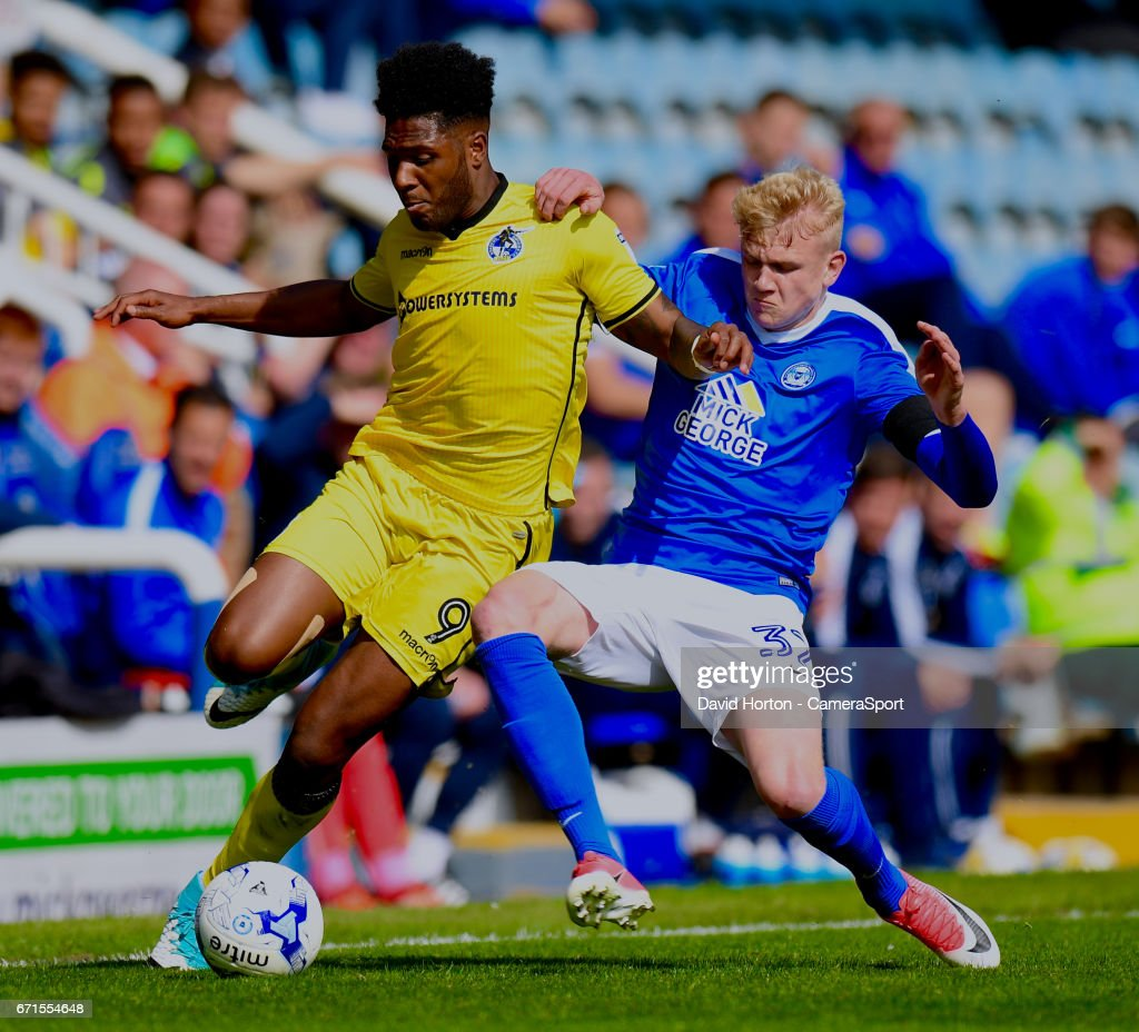 Peterborough United's Lewis Freestone (R) battles with Bristol Rovers' Ellis Harrison (L) during the Sky Bet League One match between Peterborough and Bristol Rovers at ABAX Stadium on April 22, 2017 in Peterborough, England.