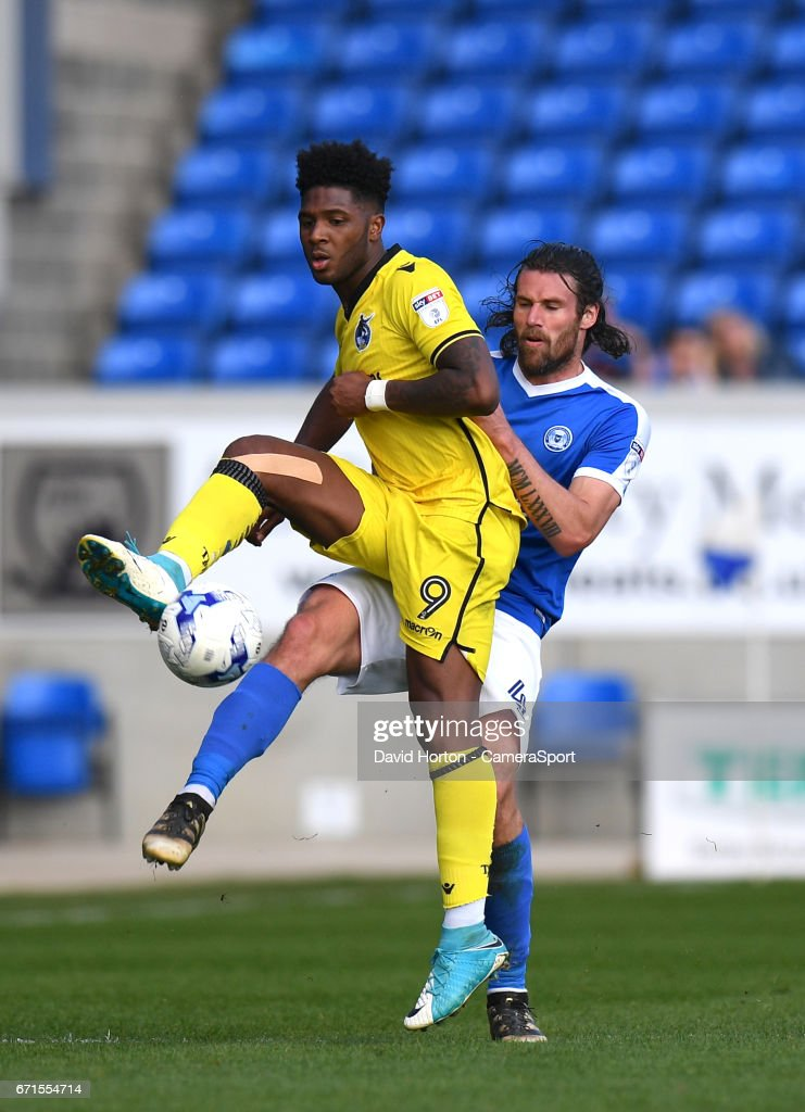 Peterborough United's Michael Bostwick (R) battles with Bristol Rovers' Ellis Harrison (L) during the Sky Bet League One match between Peterborough and Bristol Rovers at ABAX Stadium on April 22, 2017 in Peterborough, England.