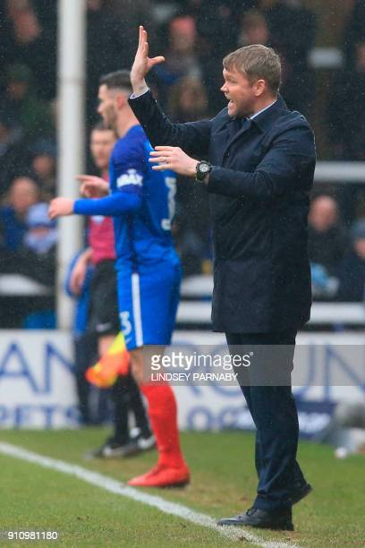 Peterborough United's Northern Irish manager Grant McCann gestures during the touchline during the English FA Cup fourth round football match between...