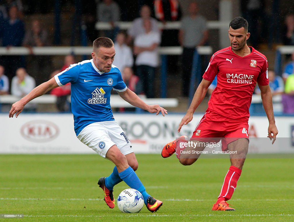 Peterborough United's Paul Taylor takes on Swindon Town's Conor Thomas during the Sky Bet League One match between Peterborough United and Swindon Town at ABAX Stadium on September 3, 2016 in Peterborough, England.
