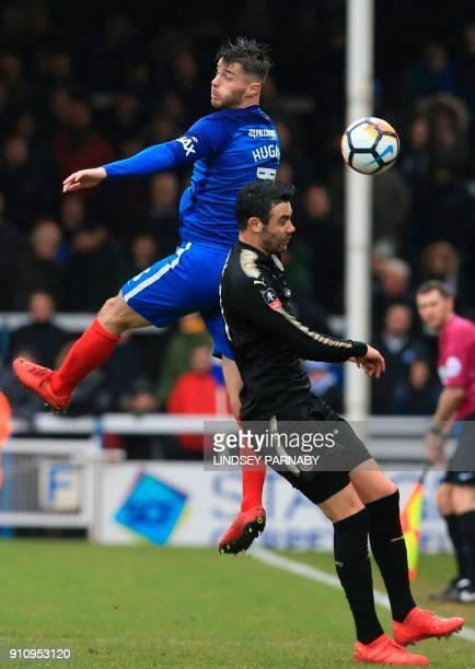 Peterborough United's Welsh defender Andrew Hughes beats Leicester City's Spanish midfielder Vicente Iborra in the air during the English FA Cup...