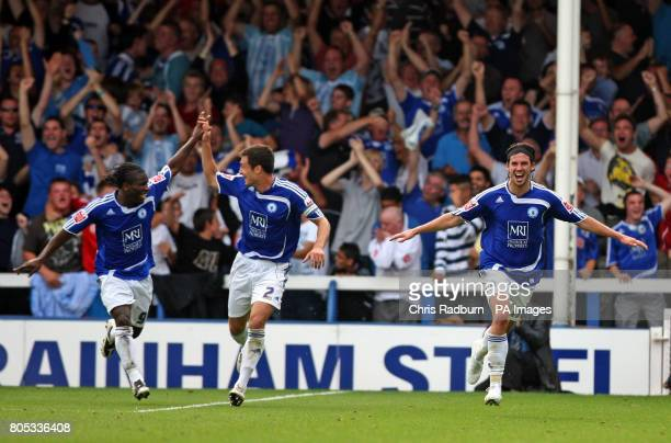 Peterborough's George Boyd celebrates his goal with team mates Aaron McClean and Russell Martin during the CocaCola Championship match at London Road...