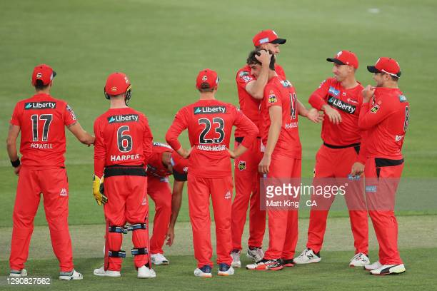 PeterHatzoglou of the Renegades celebrates with team mates after taking the wicket of JhyeRichardson of the Scorchers during the Big Bash League...