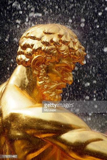Peterhof Fountains. Russian Gold Gilded Bronze Statue of a man situated in the Lower Park at Peterhof near St Petersburg Russia