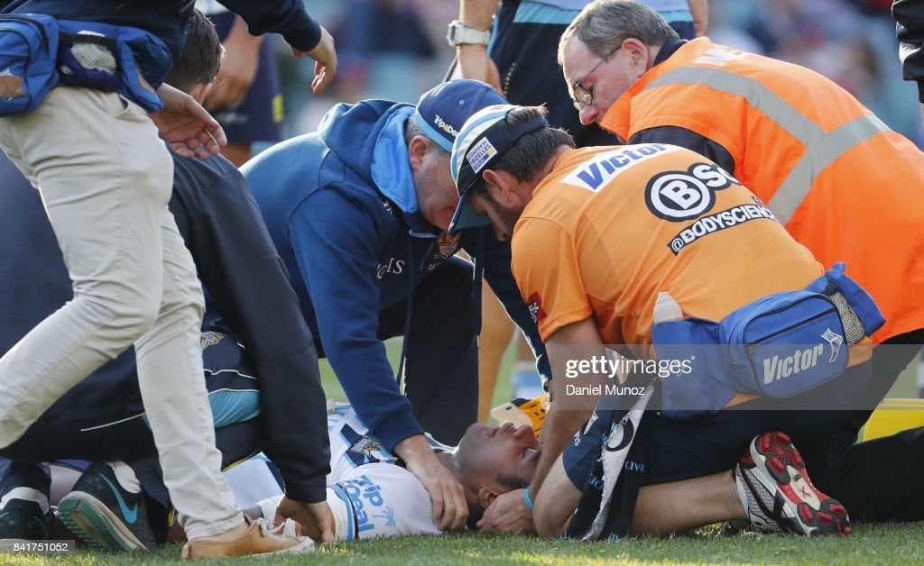 Petero Benjamin Nakubuwai of the Titans receives medical attention during the round 26 NRL match between the Sydney Roosters and the Gold Coast Titans at Allianz Stadium on September 2, 2017 in Sydney, Australia.