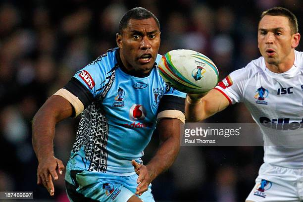 Petero Civoniceva of Fiji passes the ball during the Rugby League World Cup Group A match at the KC Stadium on November 9 2013 in Hull England