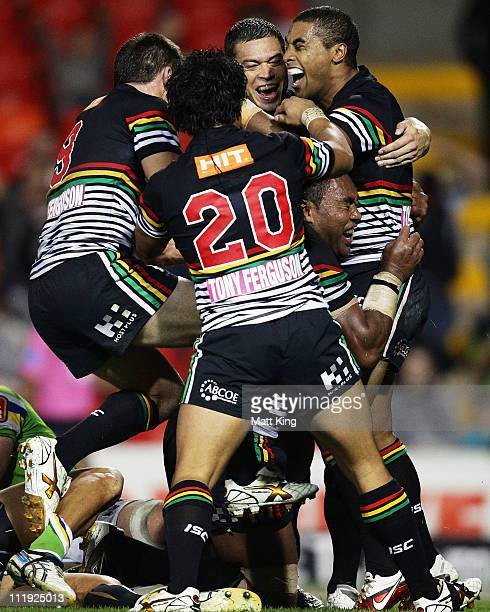 Petero Civoniceva of the Panthers celebrates with Michael Jennings and Timana Tahu after scoring a try in the final seconds during the round five NRL...